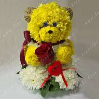 """Flower bear with a heart"""
