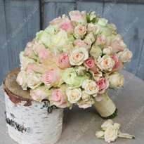 Delicate bouquet of roses from the bride